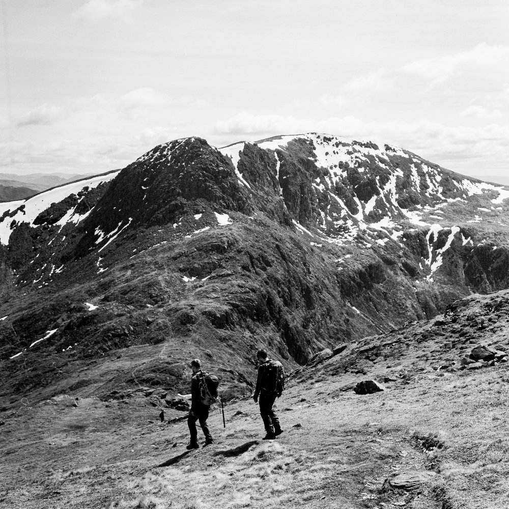 Al and Ferg descending from Ben Vorlich - Kodak TMax 400.