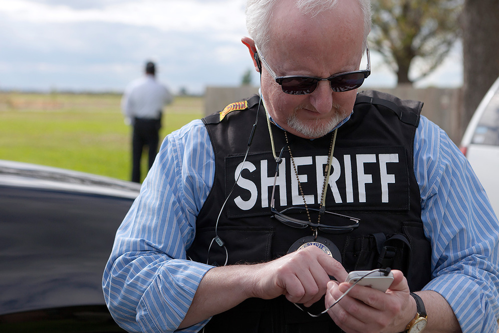 "4:48 PM  - As deputies search the suspect's house, Richard Logan texts his wife. She replies, "" Are you back to being a pharmacist or are you still a cop? "" He replies, "" COP "". She replies, "" Coming home tonight ?"""
