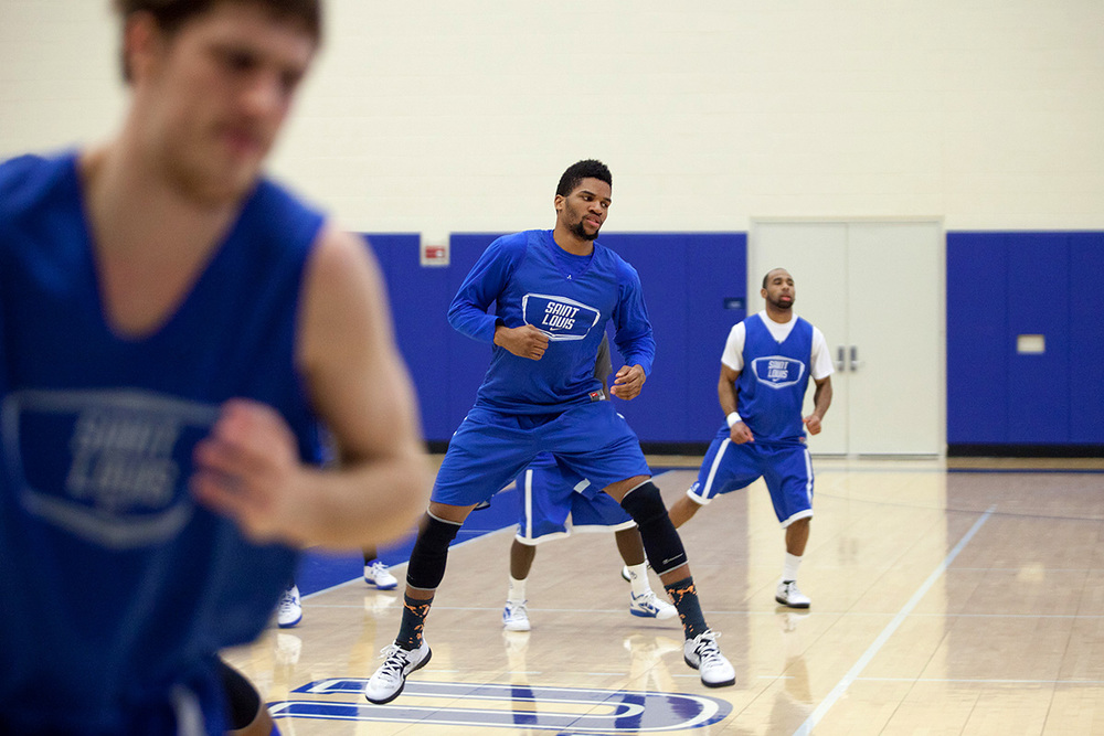 Rob Loe, (left to right) Dwayne Evans and Kwamain Mitchellgo through their basketball team practice routine.