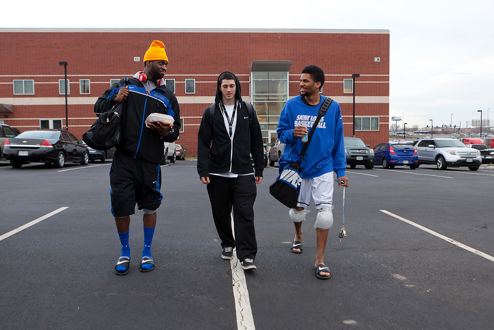 Corey Remekun, (left to right) Sean Duff and Dwayne Evans, all of SLU's Basketball team, walk back to the dorms after practice and a team dinner.