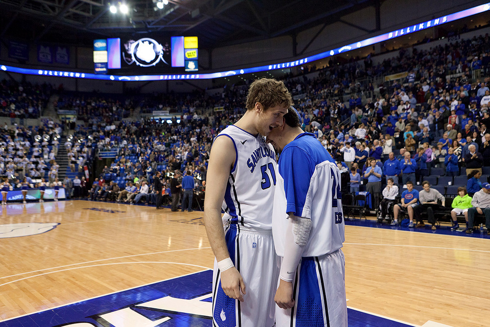 Cody Ellis (right) puts his head on fellow forward Rob Loe's shoulder before the game. This would be Ellis's last game at home as a graduating senior.
