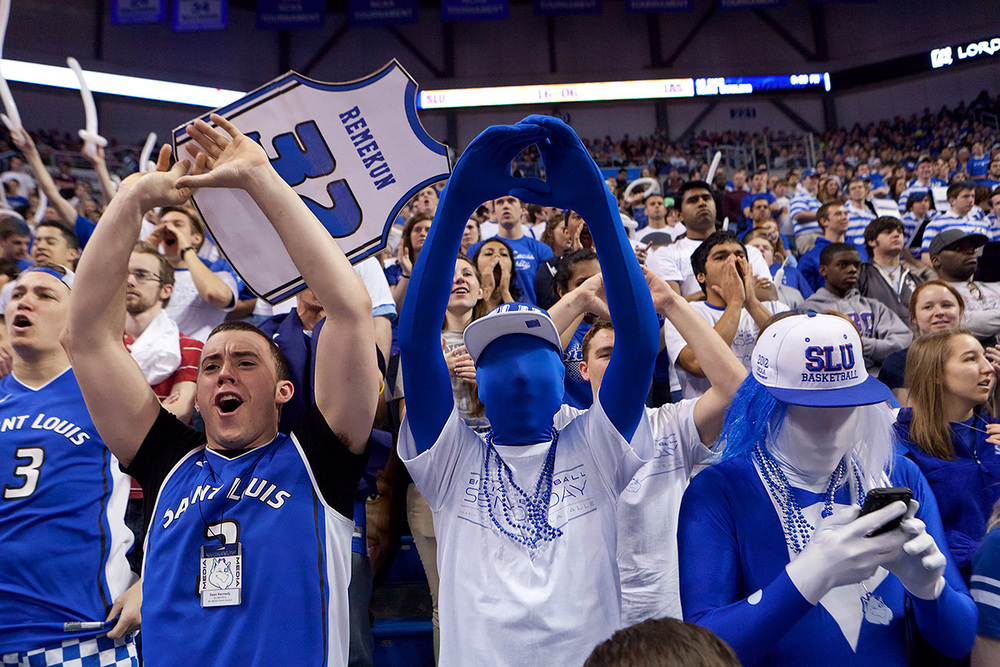 Students cheer for the SLU basketball team as they play against game against LaSalle.