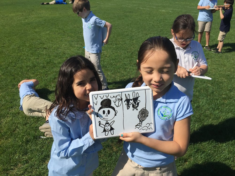Students enjoy whiteboard drawing from observation outside Spring of 2018