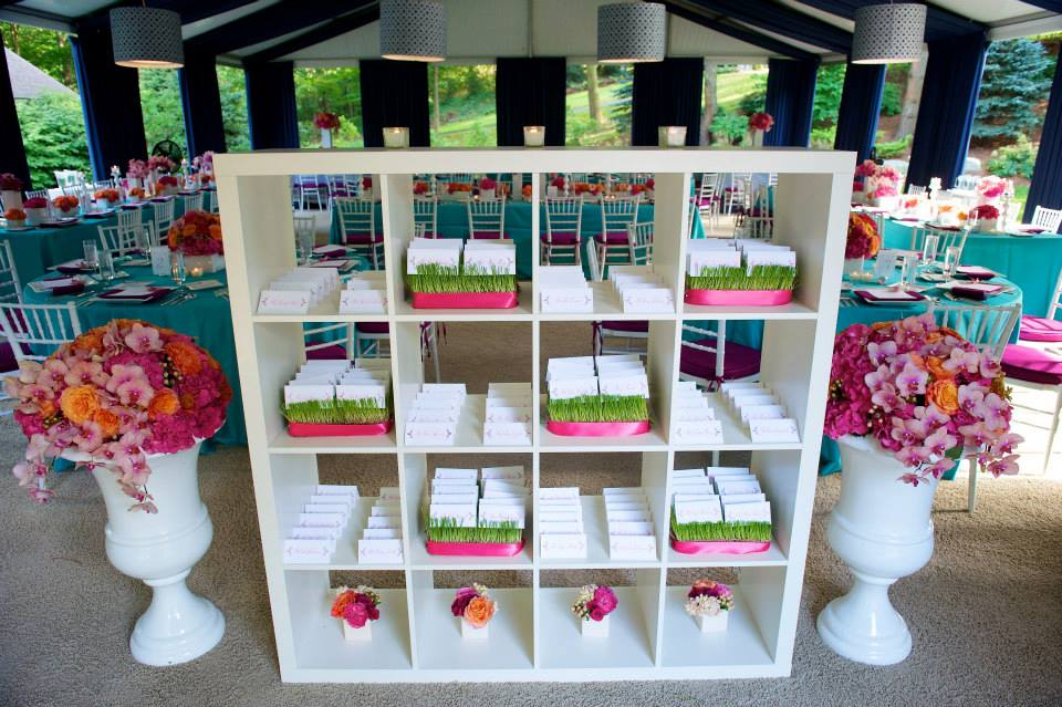 white shelf with wedding seating chart