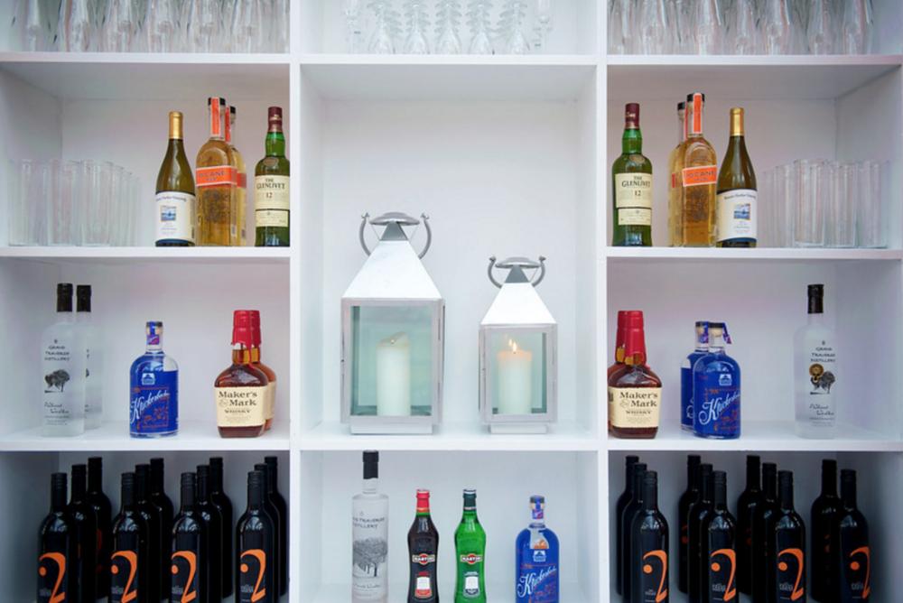 fun bar set up on white shelf