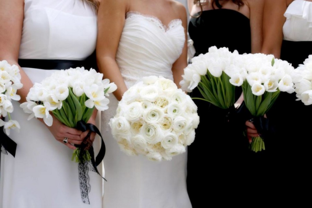 bride and bridesmaids with black and white floral bouquets
