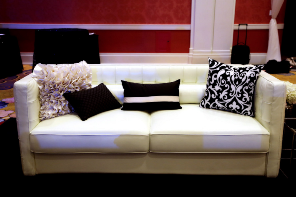 modern white couch in hotel wedding