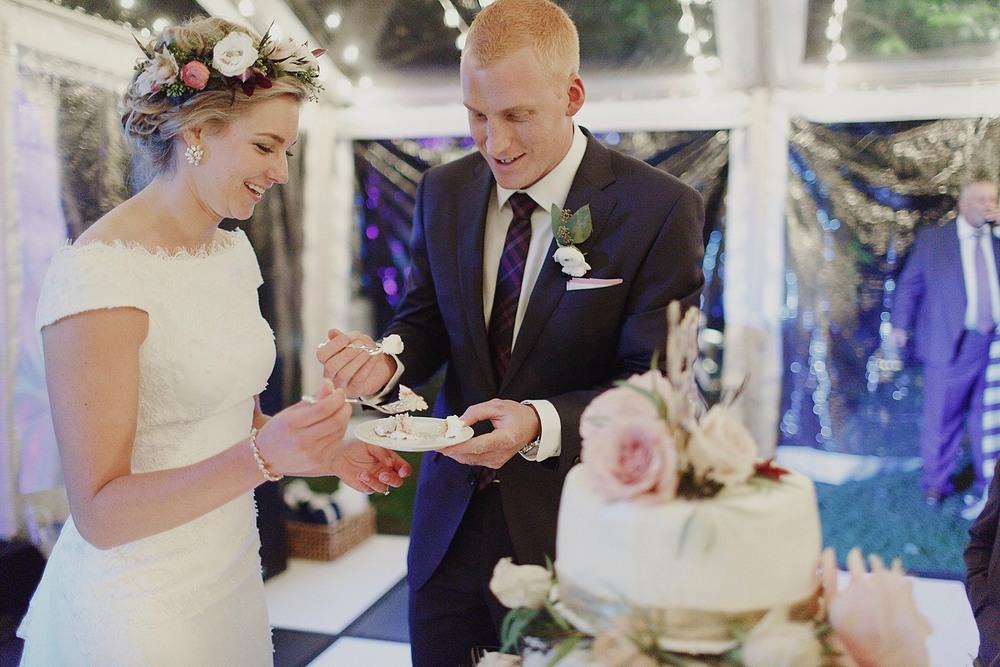 Blythefield Country Club Elegant Tented Wedding Bride and Groom Cutting Cake