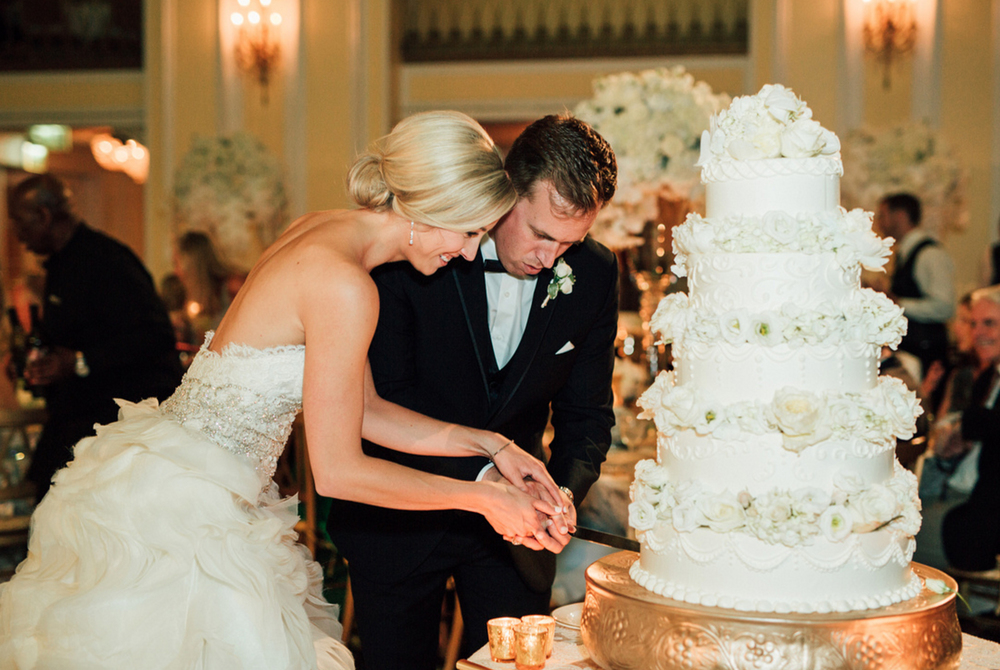 001wedding cake being cut by bride and groom in amway grand ballroom hotel.jpg