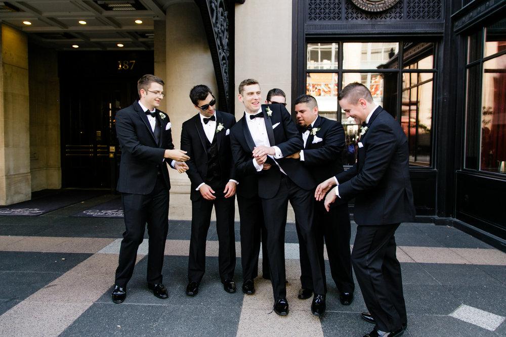 Downtown Grand Rapids Hotel Wedding Groom Photos