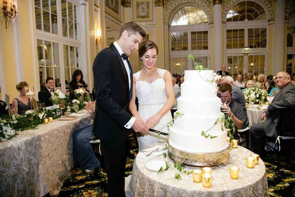 Amway Grand Plaza Wedding Couple Cutting Cake