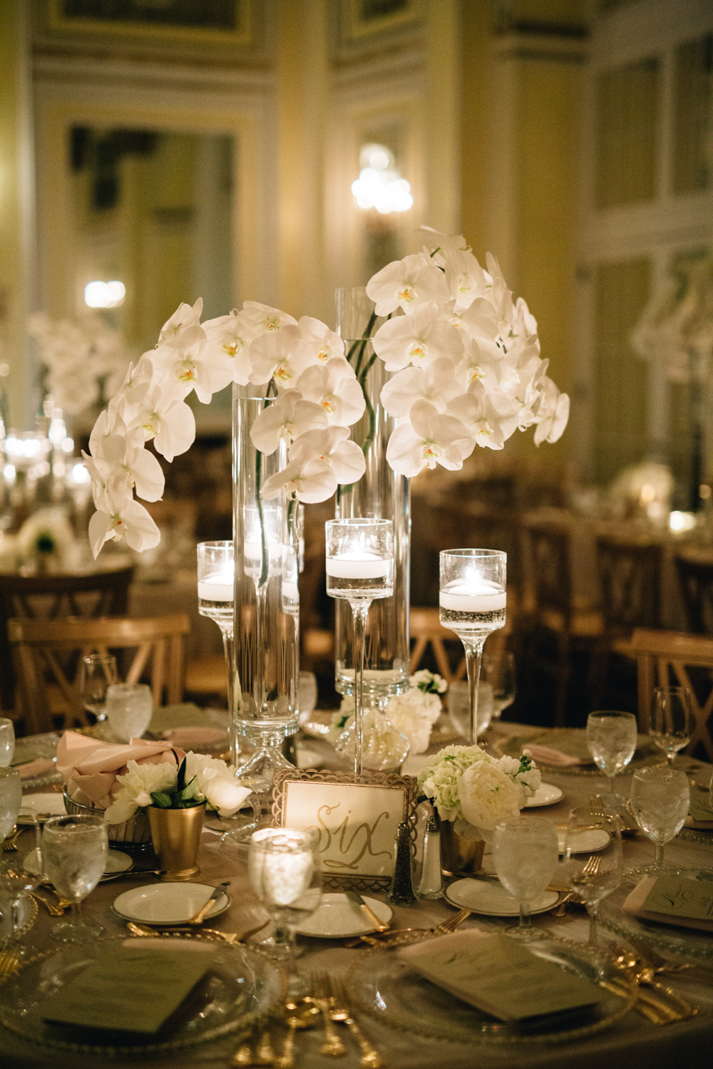 Amway Grand Plaza Hotel Wedding with Orchid Centerpieces