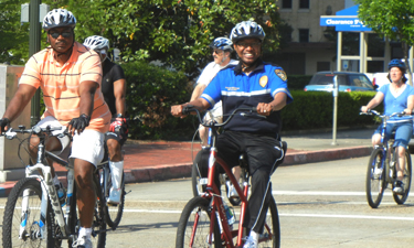 Former Mayor Kip Holden riding as part of the Annual Mayor's Family Bike Day. Photo: Parks & Recreation Magazine.