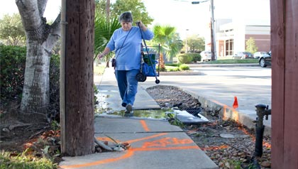 Broken sidewalks are challenging to navigate.