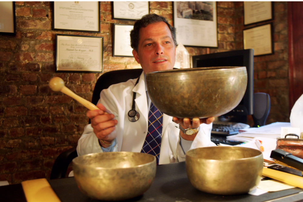 Dr. Mitchell Gaynor, with Tibetan singing bowls in a Manhattan office in 2005, advocated natural and traditional medicine.     CreditJoyce Dopkeen/The New York Times