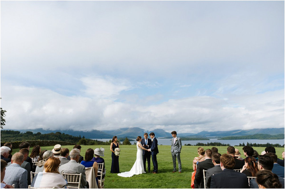 Couple saying wedding vows at a wedding ceremony overviewing Loch Lomond landscape