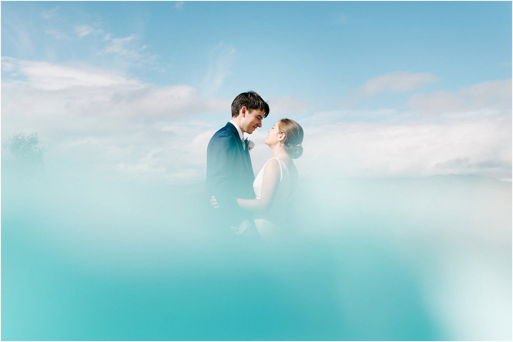 Beautiful romantic couple wedding portraits in the sky by Cro and Kow
