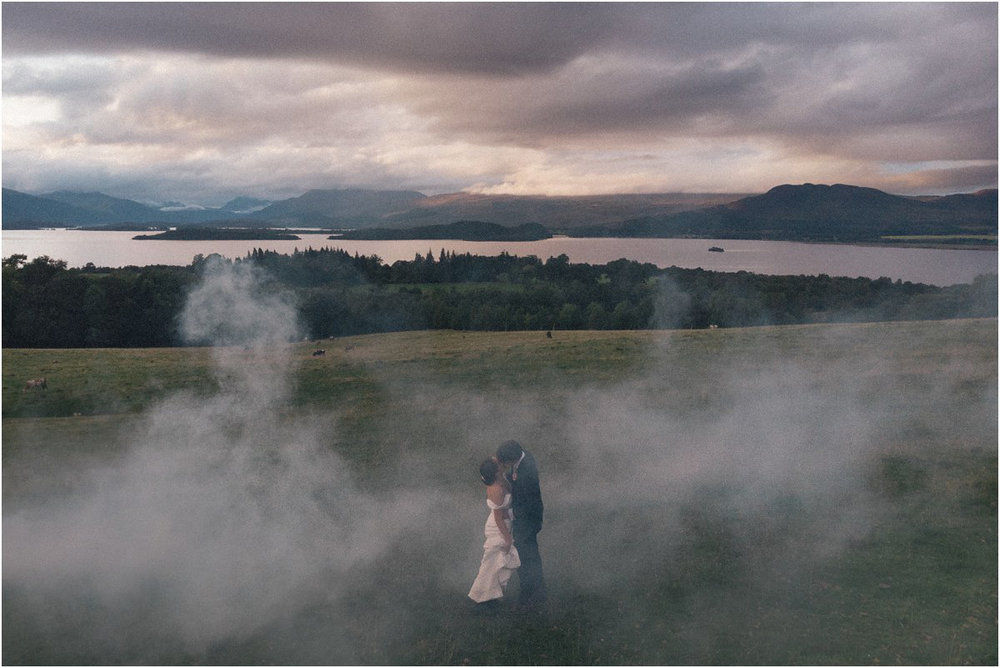 Wedding couple portraits in the sunset and fog on top of a mountain in the evening by Cro & Kow