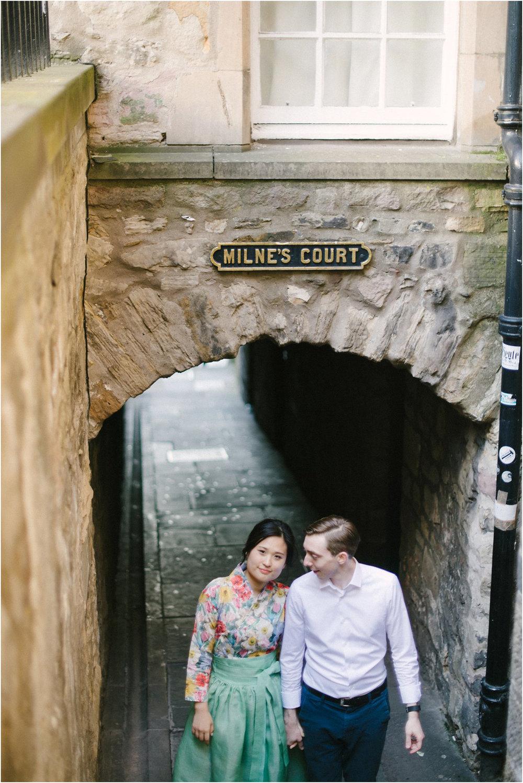 Korean Bride and British groom standing in Edinburgh Old Town Close