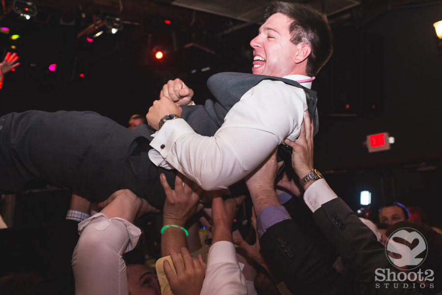 crowd surfing at wedding