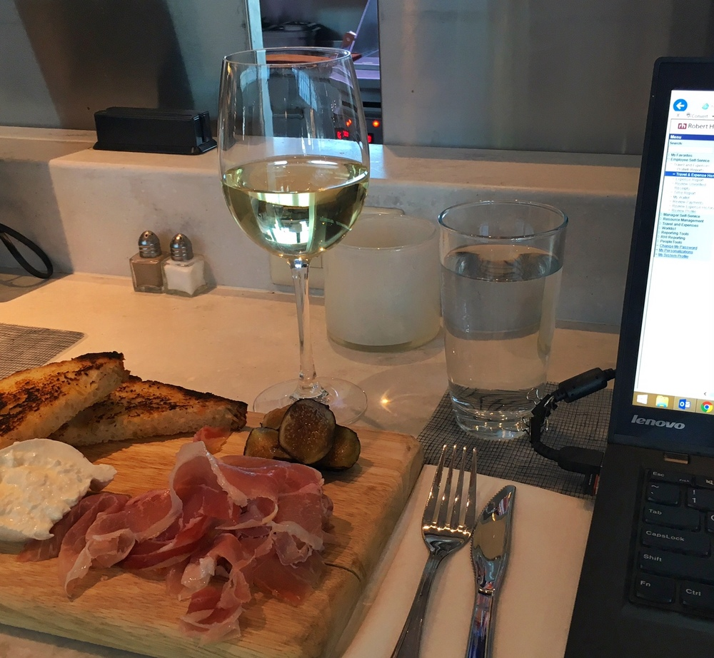 "Savvy B, prosciutto, burrata, plus toast points and figs to go along with my ""work."""