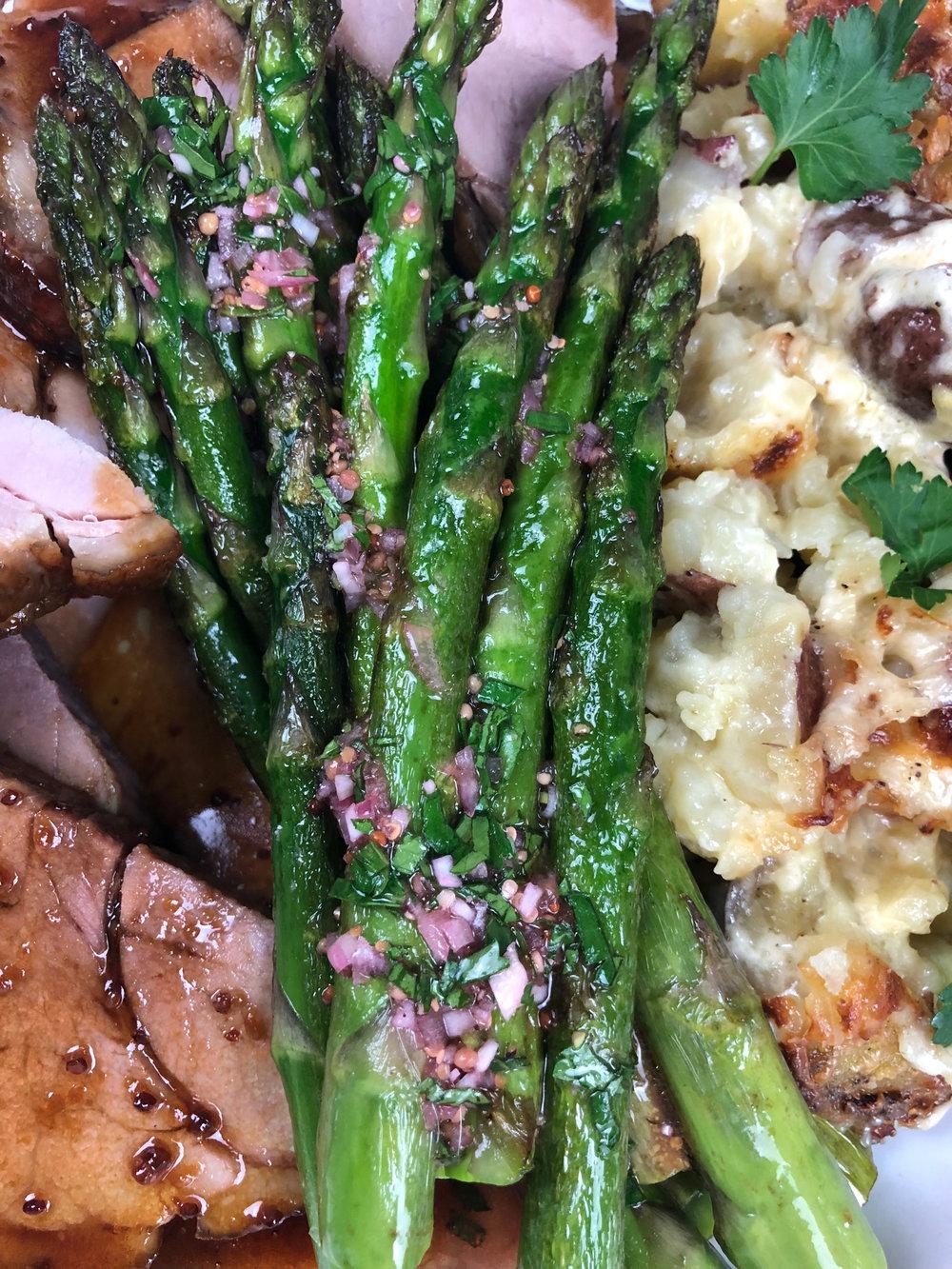 Asparagus with Blood Orange Vinaigrette, served with Broad Arrow Farm  Smoked Ham  and Smashed Potatoes Au Gratin.