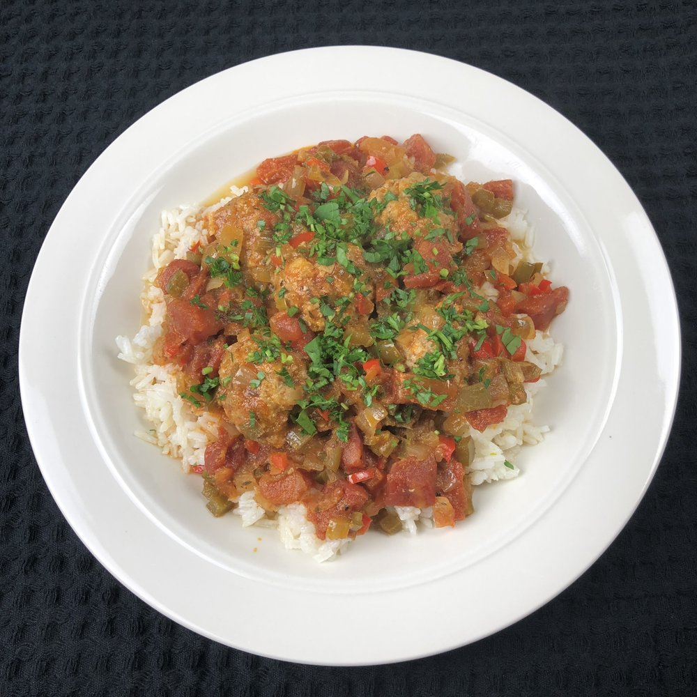 Cajun pork meatballs served over rice with sauce piquant.  Laissez les bon temps rouler !