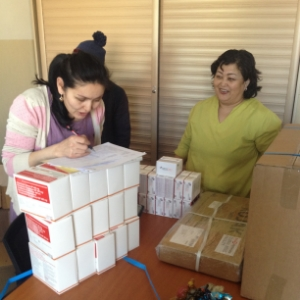 Pharmacists in Mongolia receiving shipment of medicines for Stage 2.