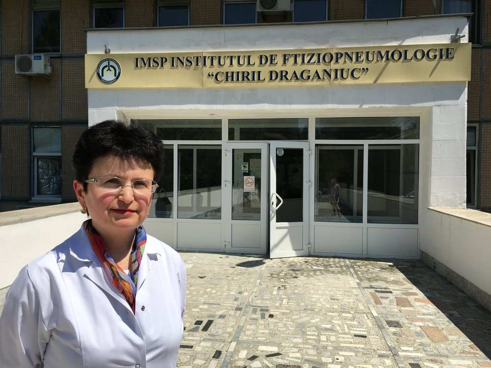 """Dr. Elena Tudor in front of the Institute of Phthisiopneumology """"Chiril Draganiuc"""" in Chisinau, Moldova."""