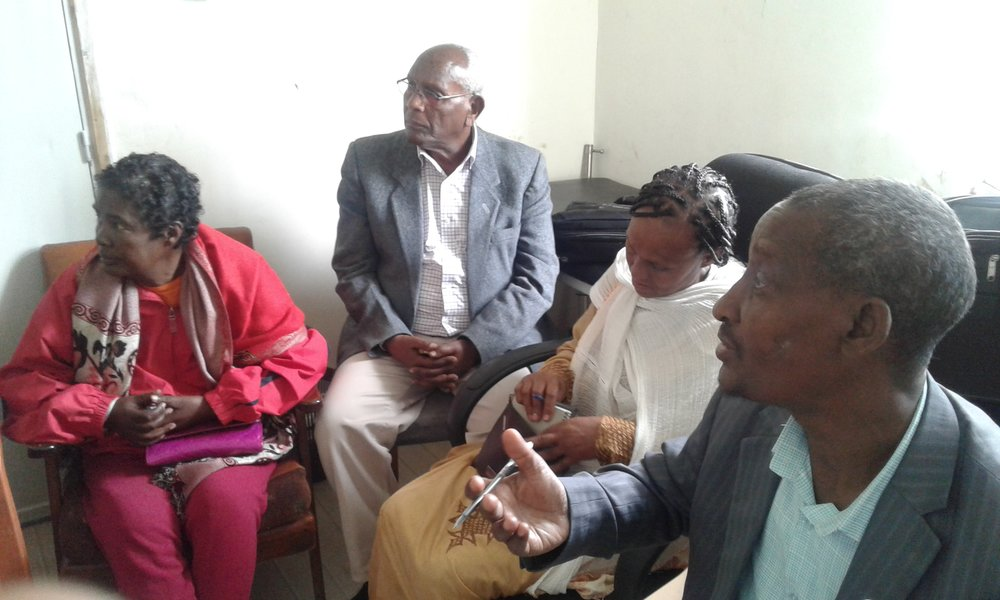 Members of the CAB discuss TB related challenges with healthcare workers at the shelter