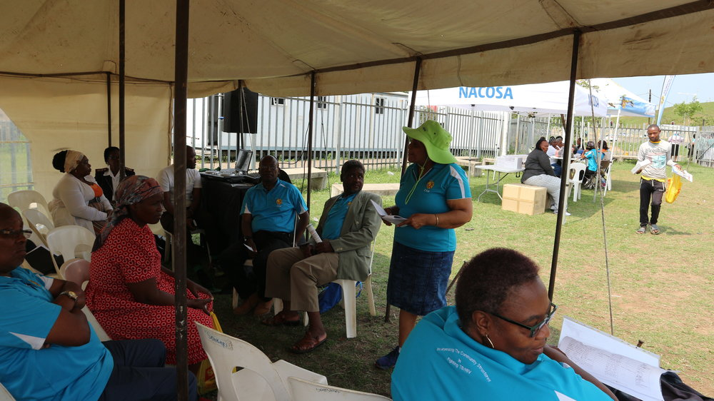 Community members gathered at the outreach event to learn about TB, MDR-TB and HIV.