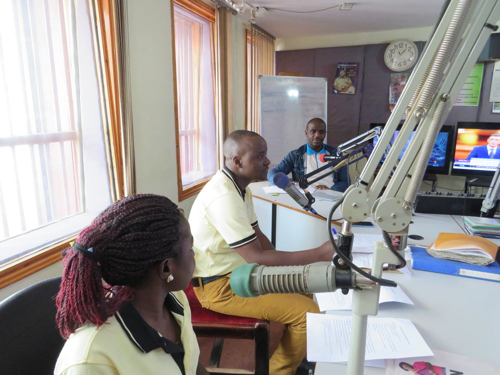 Members of the Community Advisory Board for the Makerere University Lung Institute in Kampala take part in a radio show to raise awareness about the tuberculosis and multidrug-resistant tuberculosis.