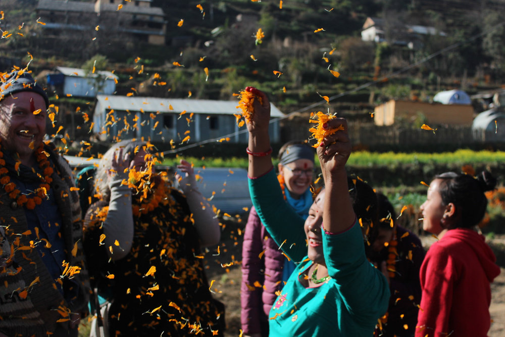 Nepal_Village_Throwing petals.jpg