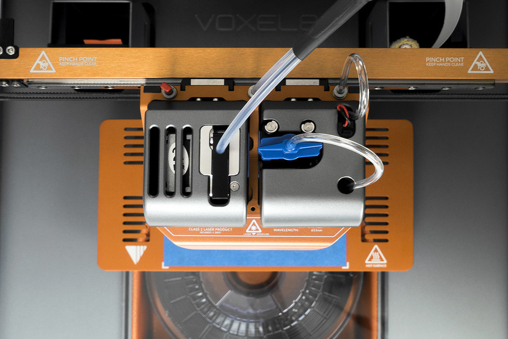 Co-printing of thermoplastics and highly conductive silver inks with the Voxel8 Developer's Kit