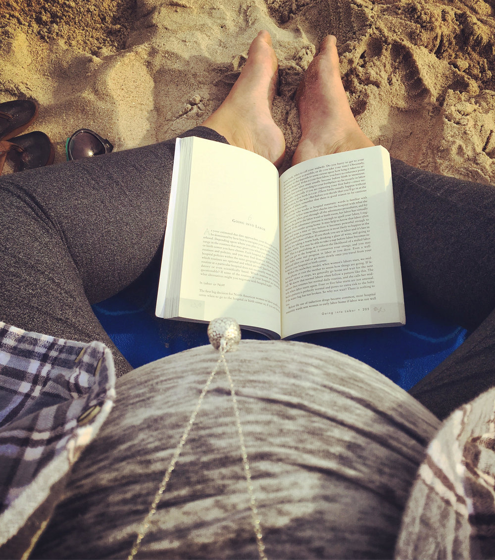 On the beach reading Ina May's Guide to Childbirth...