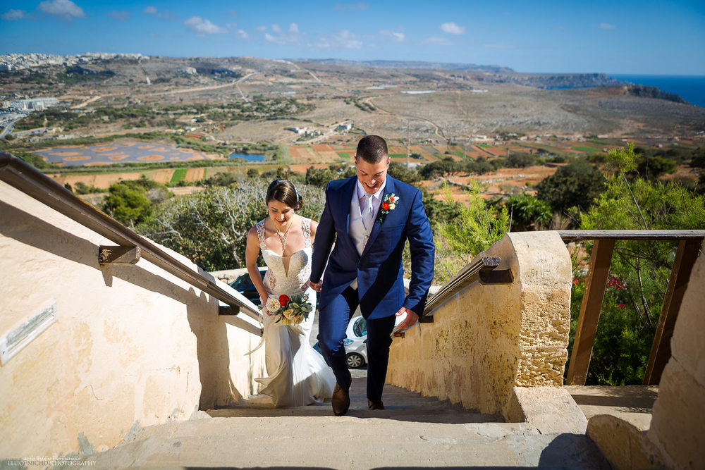 Bride and Groom climb the starts into the red tower at mellieha malta