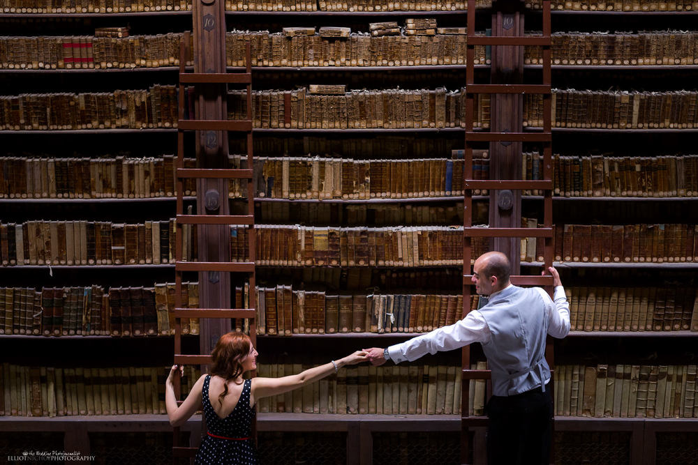 books library national valletta engagement session couple shelves