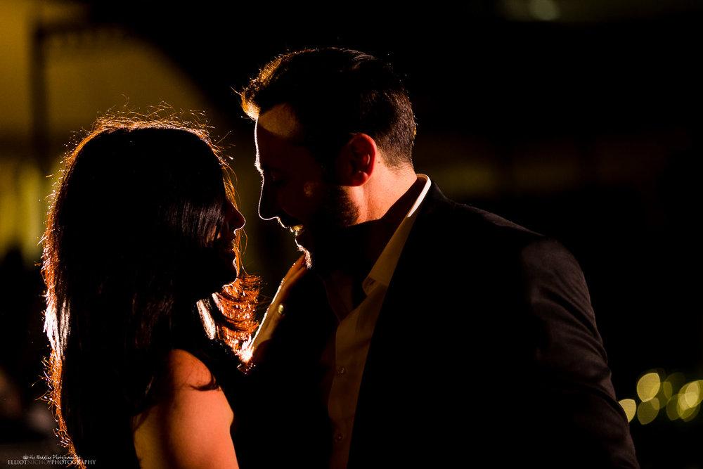 wedding guests dancing backlight