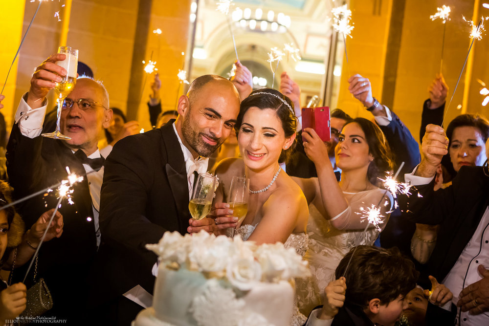 bride and groom cake cutting with sparklers at palazzo parisio malta