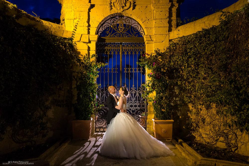 bride groom portrait palazzo parisio garden gate