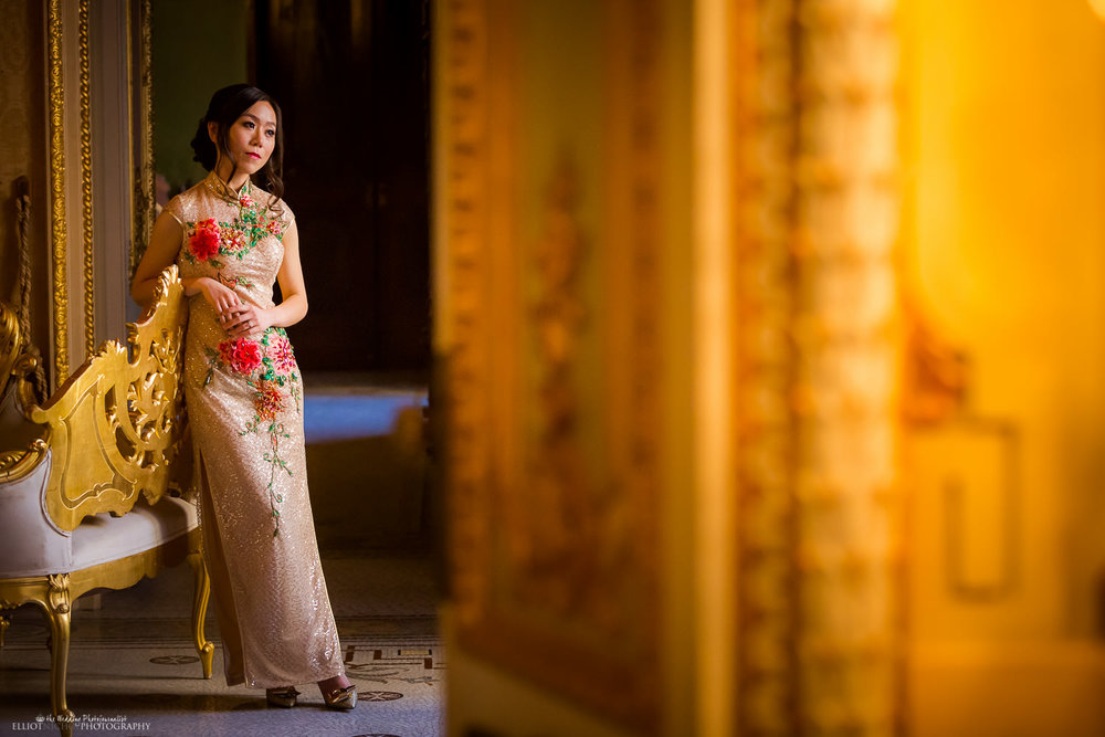 Bride in her Chinese wedding dress in the Palazzo Parisio, Naxxar, Malta