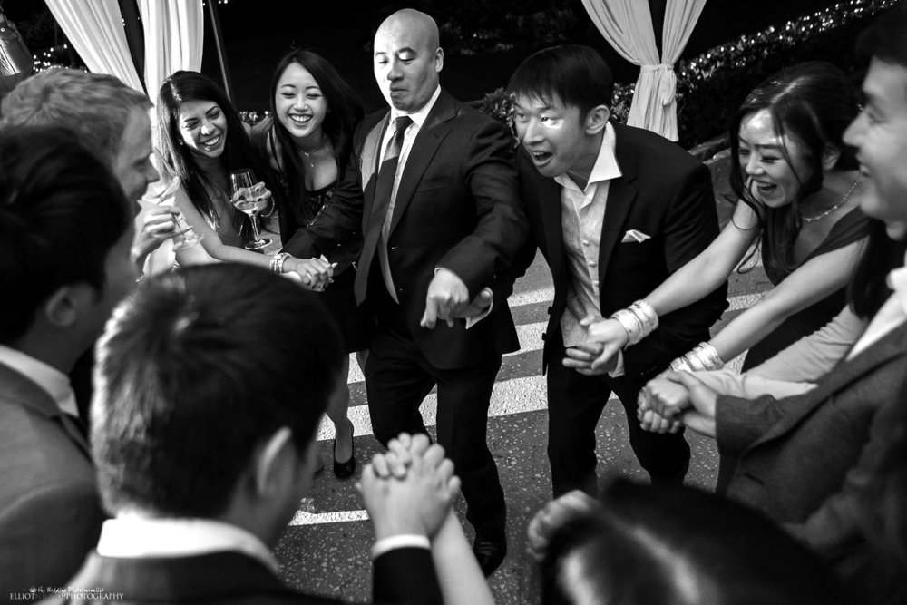 Bride and groom dance with their guests and party