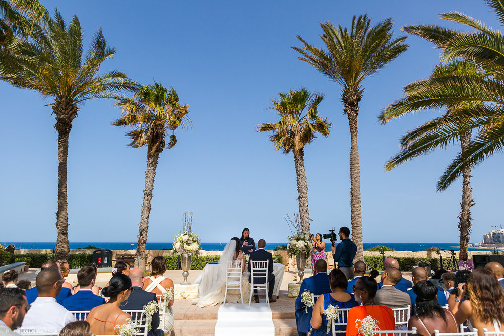 Wedding ceremony with view of the sea under palm trees