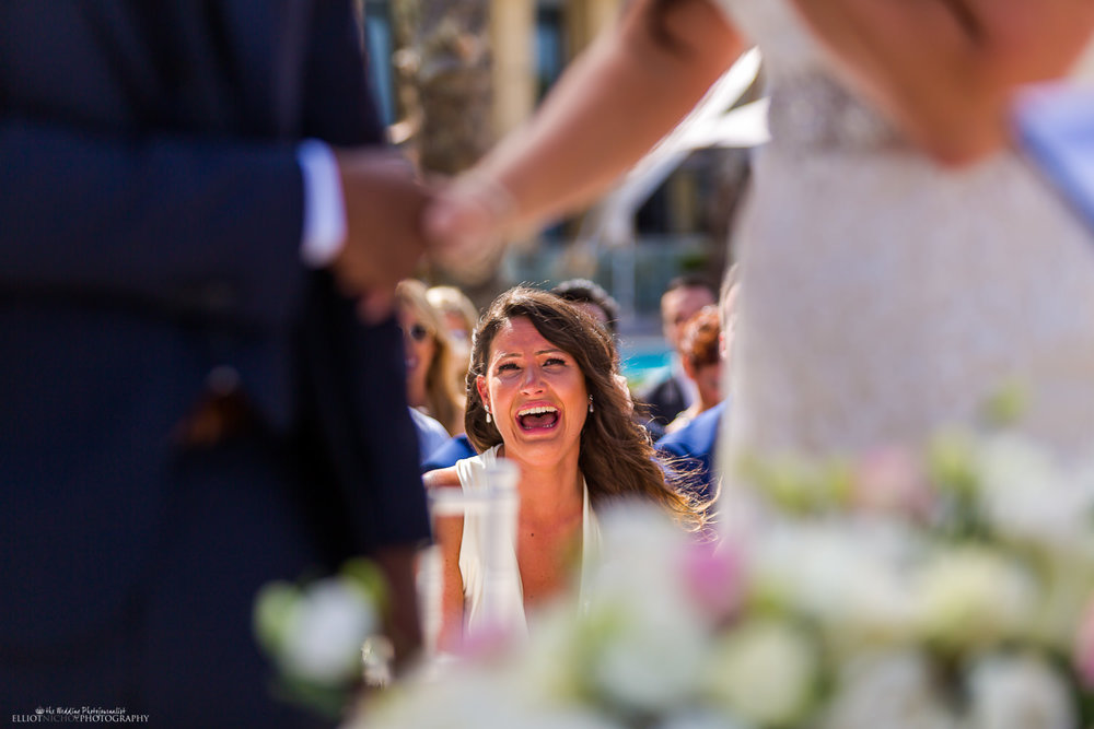 Emotional bridesmaid cries with happiness during the wedding ceremony