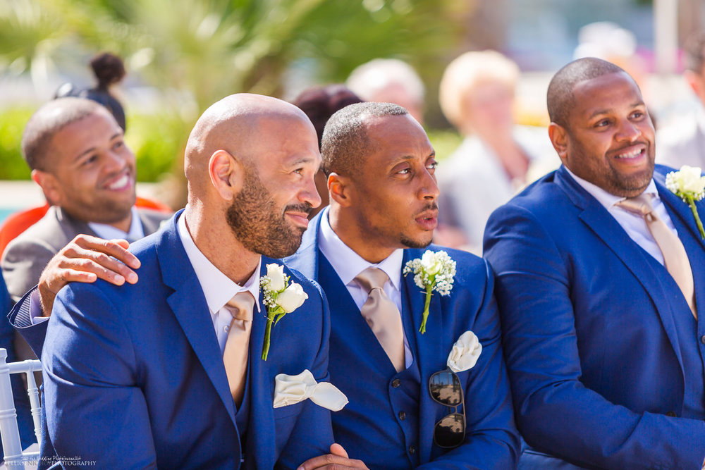 Groomsmen watch the wedding ceremony