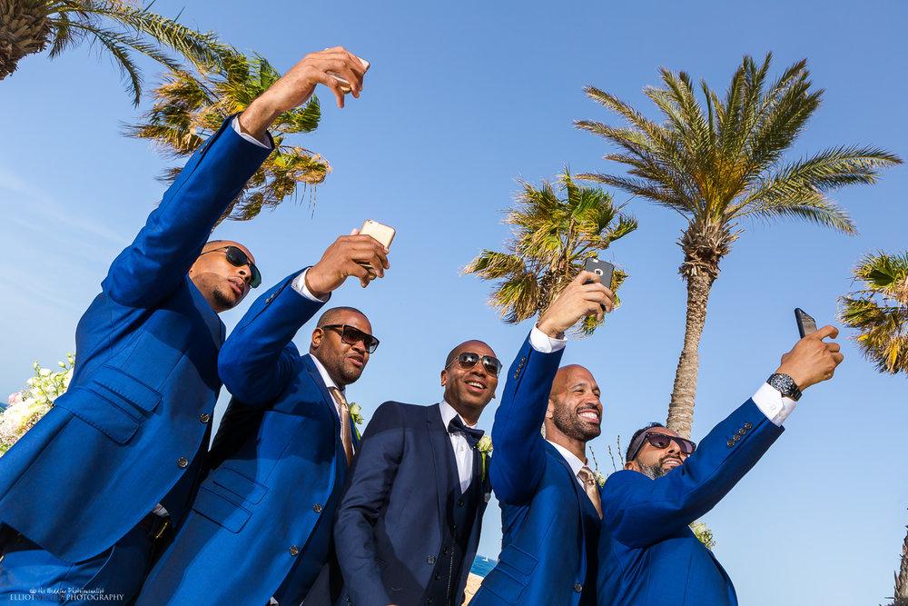 Groomsmen take selfie with groom