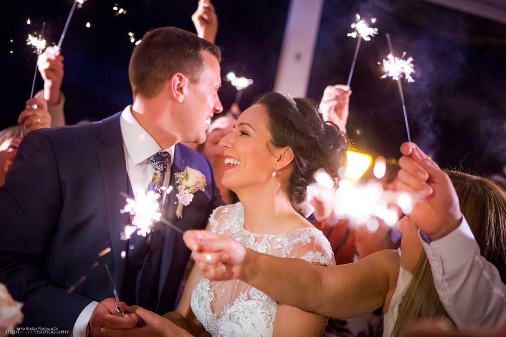Bride and Groom surrounded by sparklers during the wedding reception.