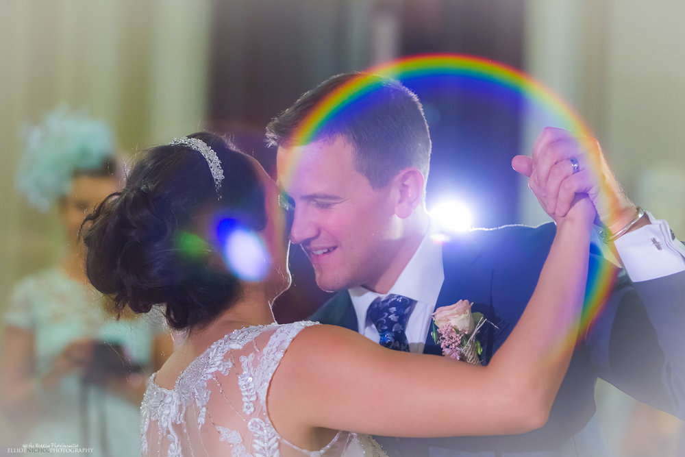 lens flare from lights while bride and groom have their first dance