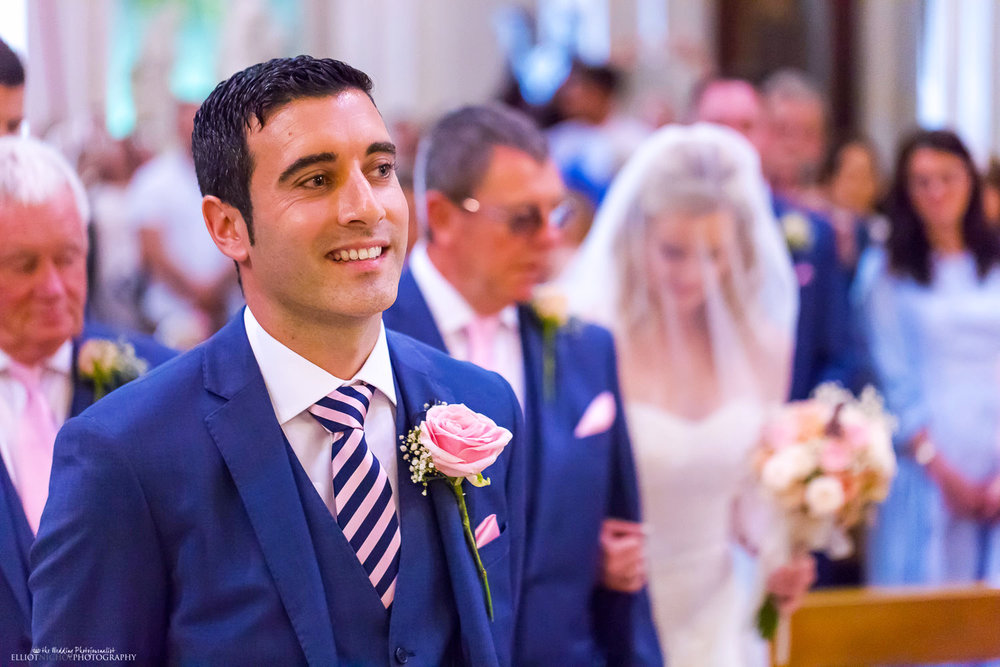 Groom about to meet his Bride at the altar in Church