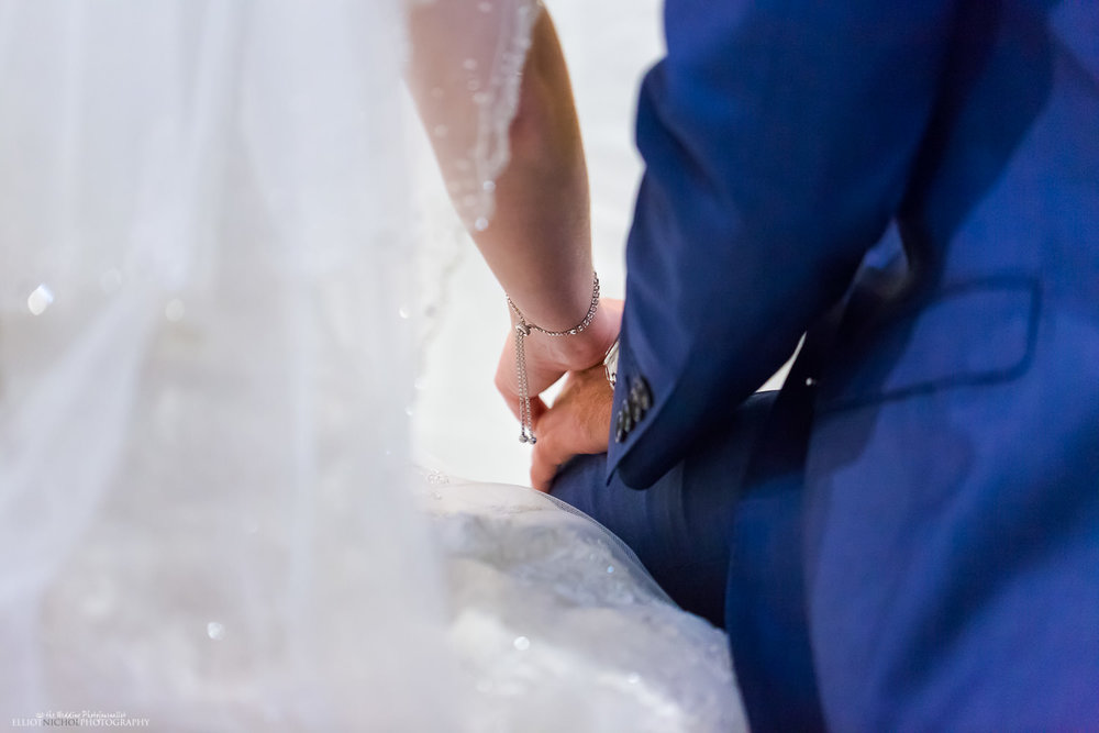 Bride anf groom holding hands during the wedding ceremony in church